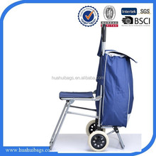 Blue travel bags on wheel with foldable chair