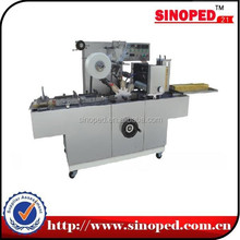 Cellophane overwrapping machine with gold tear tape