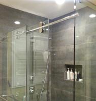 Elegant frameless glass sliding shower room