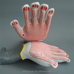 Knitted hand gloves with pvc dots