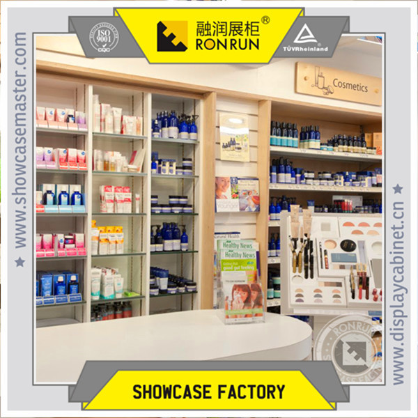 Cosmetic shop interior design with make up display wood counter ...