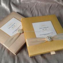 old Gold luxury gatefold silk invitations box with brooch