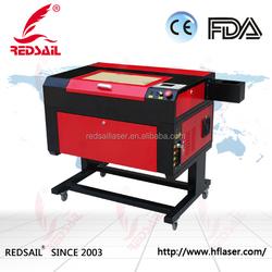 China Redsail 50W Hot Sale Red Dot Pointer Paper Cutter CO2 Laser Cutting Machine