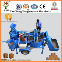 Popular machine to make clay blocks M7MI Twin hydraform interlocking block making machine