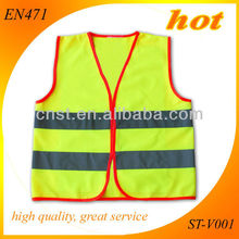 fluorescent yellow kids safety vest with red piping