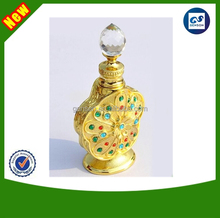 2014 newest high grade round packing bottle gold alloy face perfume bottle with Middle East style