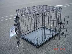 black metal wire dog crate