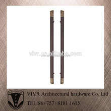 elegant brass door pull handles with black leather for hotel gate