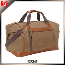 Middle size canvas leather foldable travel bag factory price travel bag with trolley