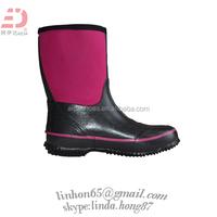 shiny and sexy girl horse riding rubber rain boots