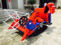 Self-propelled wheat and rice tracked type combine harvester for paddy and dry field