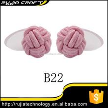 pink silk knot button