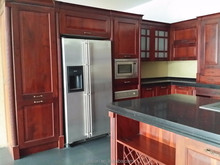 wooden kitchen island and contemporary kitchen lighting united to kitchen cabinets design