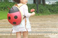 Decorative green ladybug design baby carrier backpack