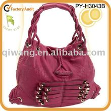 fashion double handle leather hobo bag with an edgy side with braid and stud detailing.