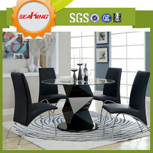 New design contemporary dining round table with clear glass top and curved stainless steel legs