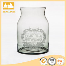 round colored glass vase with decal