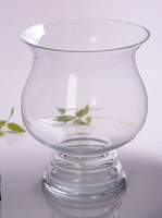 Tall clear glass candle holder