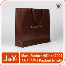 Brand new brown shopping paper hand bag with embossed logo