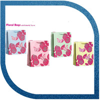 floral bag with butterfly tip-on garment packaging bags