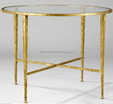 Antique round coffee table with tempered glass top and chromed gold color base for hotel
