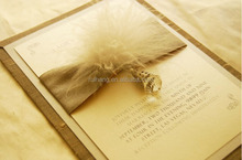 luxurious and elegant wedding invitation card and wedding gift with feather