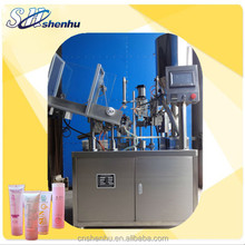 soft tube filling and sealing device