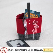 Multi colored square felt storage bag with leather handle for home sundries