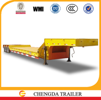 Best Selling Truck Trailer Type And Steel Material Tri-axle Heavy Duty Equipment Transporter 3 Axle Low Bed Semi Trailer