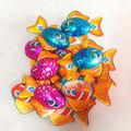 grandes desenhos animados projetados milka peixes em forma de doces de chocolate