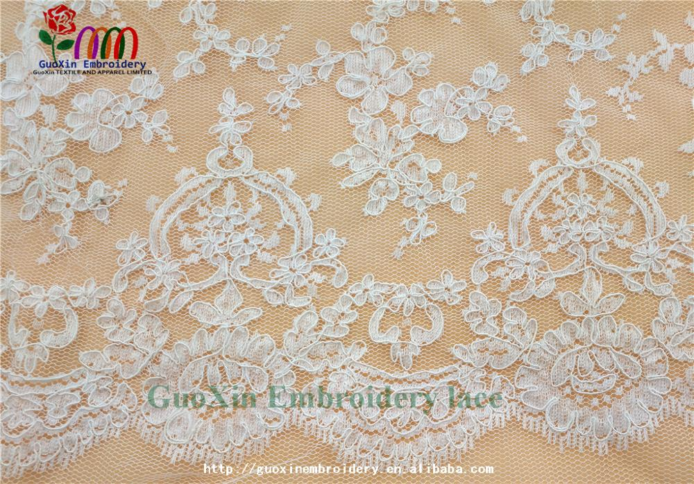 factory wholesale ivory embroidered french lace fabric with cording (5).jpg