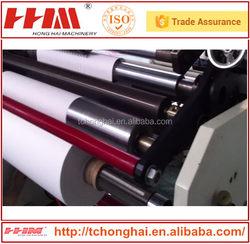 Adhesive tape log roll slitting and winding machine