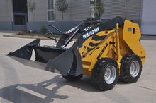 Mini skid steer loader with different attachment