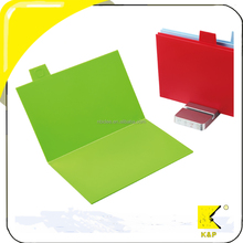 Folding cutting board set includes four different boards with non-slip base