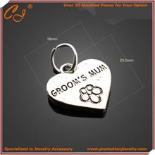 Red Copper Logo Engraving Love Hollow Heart Shaped Charm Manufacture from China
