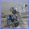 mobile hand operated machine for milking cows and goats