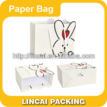 2015 Cheap fancy christmas packaging paper gift bag with handles