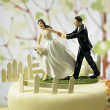 """Race to the Altar"" Couple Figurine Cake Topper"