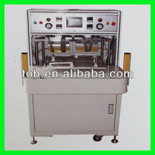 Four position rotary top-side heat sealing machine