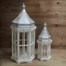 White wooden and metal lanterns for wedding center table