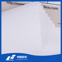 Cotton Spandex Twill Woven Stretch Fabric White Color Half Bleached Apparel Fabric China Manufacturer Lanxi Supplier