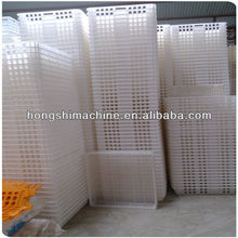 The plastic chicken transport cage