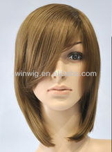 Dark Blonde medical wig, short layered hairstyle, longer at neck line.