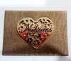 popular jeans leather label with heart design metal plate in the middle