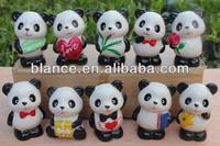 Miniature panda sculptures various designs