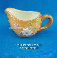 Brown ceramic milk jug with flowers design