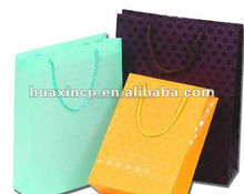 Supply paper bags for shopping use with Pantone color printing