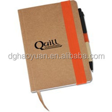 recycled note book with pen