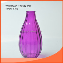 purple colored glass vase with big belly and narrow mouth