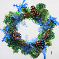 PVC pinecone bowknot decorates the christmas wreath